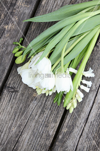 White tulips and hyacinths on weathered wooden surface