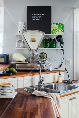 Old kitchen scales in kitchen with worksurfaces on different levels