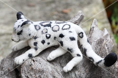 White, hand-made, felted, woollen leopard
