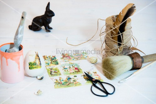 Vintage album pictures with Easter motifs, twine and old-fashioned paintbrush
