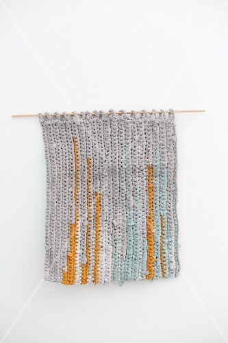 Striped wall-hanging made from recycled T-shirt yarn