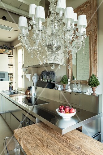 Rustic wood, stainless steel and chandelier in kitchen