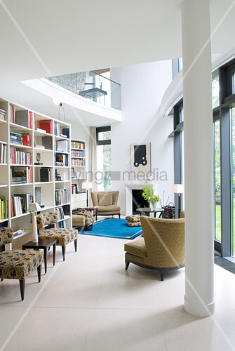 Open-plan library in modern architect-designed house with gallery level