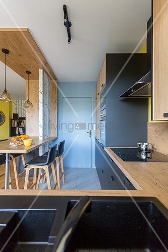 Modern kitchen-dining room in a natural style