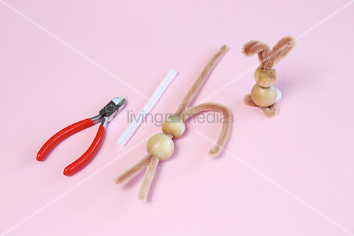Bunnies handmade from wooden beads and utensils