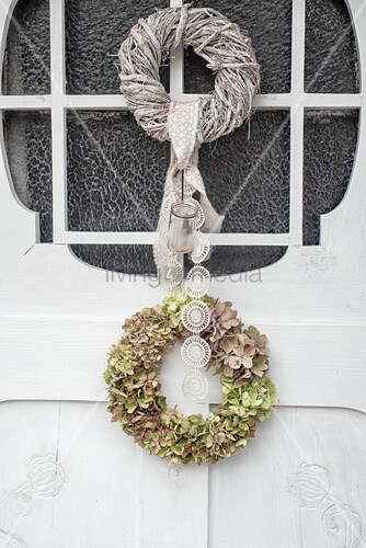 Hydrangea wreath on white wooden door