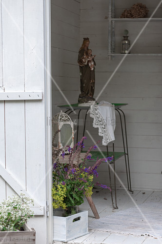 View of Madonna and bouquet of flowers in summerhouse