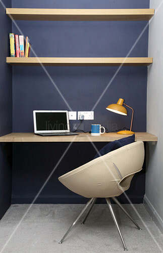 Small study space in bedroom with purple wall