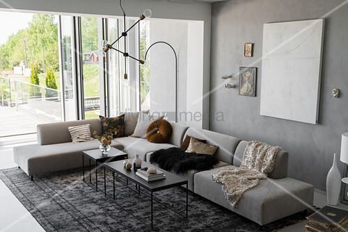 Corner sofa and floor-to-ceiling terrace doors in grey living room