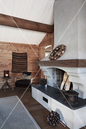 Open fireplace in rustic wooden house