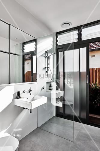 Walk-in shower in modern bathroom with garden access
