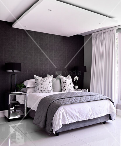 Double bed in bedroom with shiny tiled … – Buy image ...