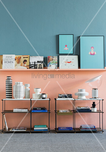 Tall wall divided into two colours with shelving below ledge
