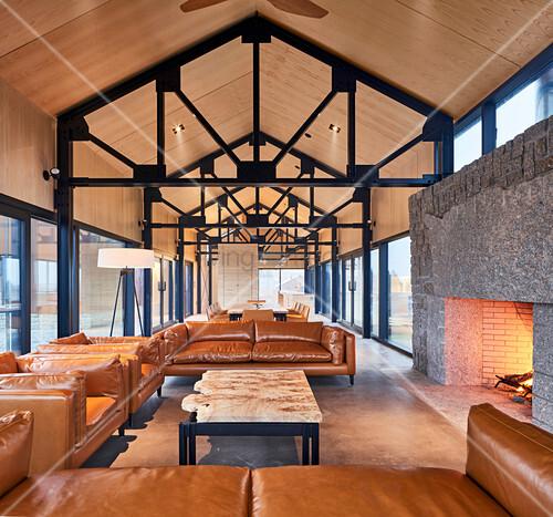 Cognac leather sofa set in open-plan interior