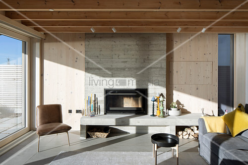 Sunlight in modern living room with concrete fireplace