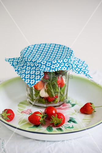Handmade wax wrap covering preserving jar