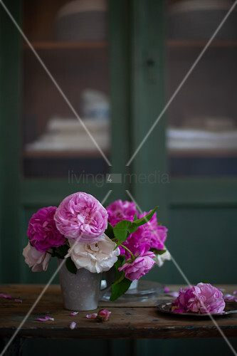 Pink and white roses in metal vase