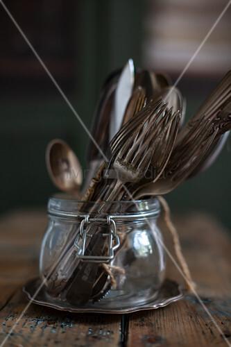 Vintage cutlery in jar