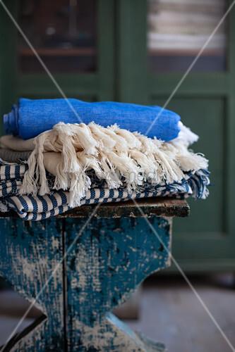 Folded tablecloths on stool