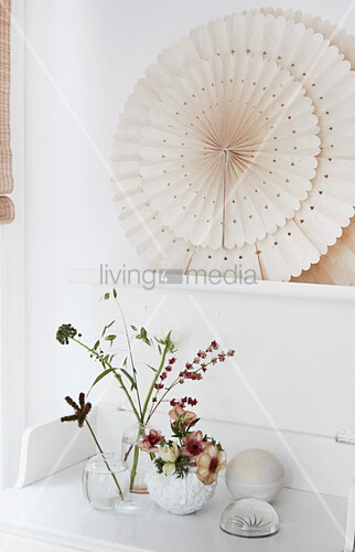 Vases of anemones and single flower stems