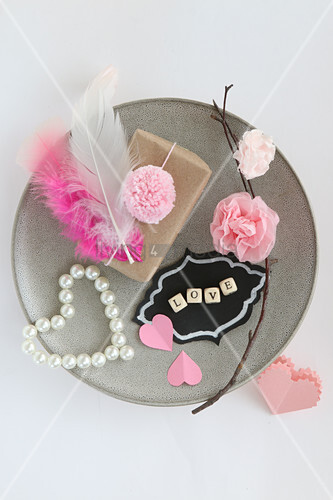 Romantic arrangement in pink on plate
