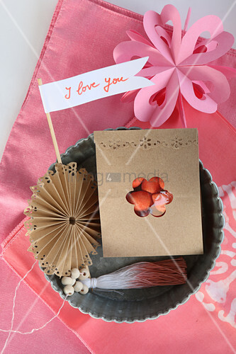 Romantic arrangement in pink with tiny pennant and bag of sweets