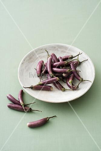 Mini aubergine ' Melanzana Perlina' in bowl