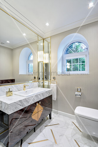 Luxurious bathroom with marble elements and gold accents