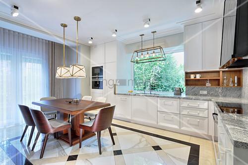 Dark wooden dining set in luxurious kitchen-dining room