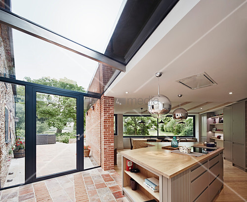 View of the dual aspect windows, doors flooding the open plan kitchen and dining space with light
