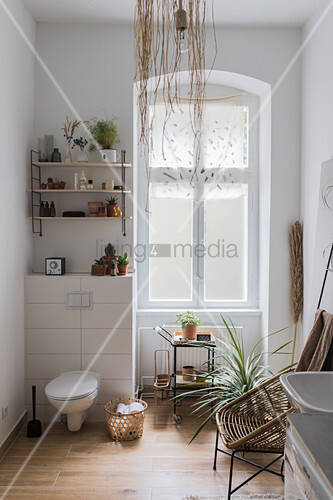 Bright bathroom in natural shades in period apartment
