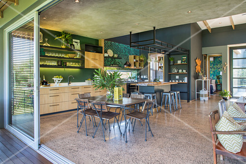 Large, open-plan industrial-style interior in grey and green