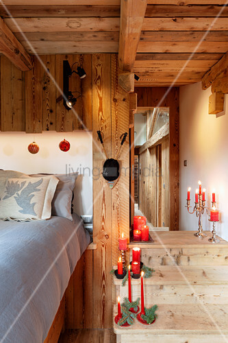 Festively decorated wooden steps in bedroom in chalet