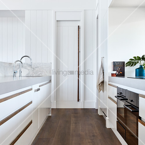 Modern kitchen with white fronts and pantry