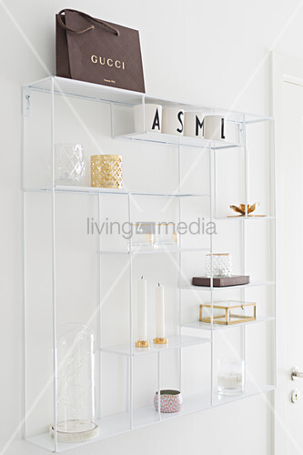 Ornaments on white, metal, open shelves
