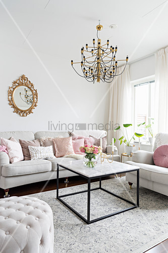 White sofa set and coffee table below window