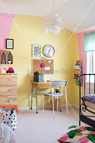 Wall painted yellow and pink in child's bedroom