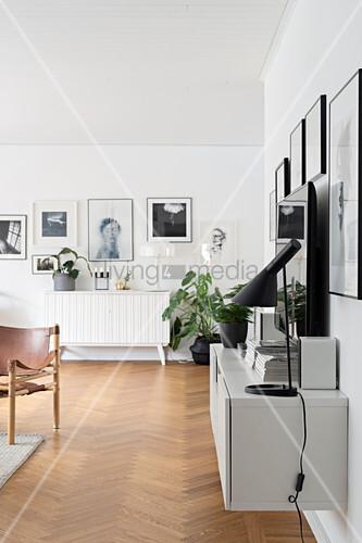 Floating sideboard in living room with herringbone parquet floor