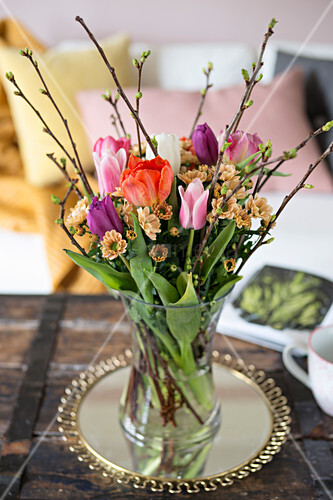 Spring bouquet of tulips, chrysanthemums and twigs