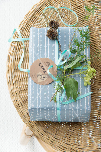 Christmas present decorated with twigs and gift tag