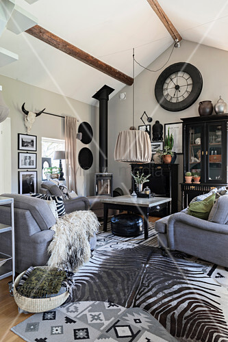 Grey sofa set and zebra-skin rug in … – Buy image – 12308714 ...