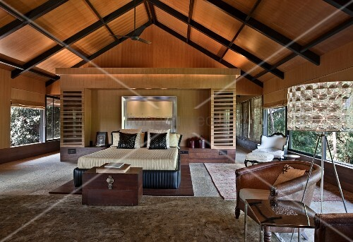 Wood-clad room with exposed roof structure and panoramic windows