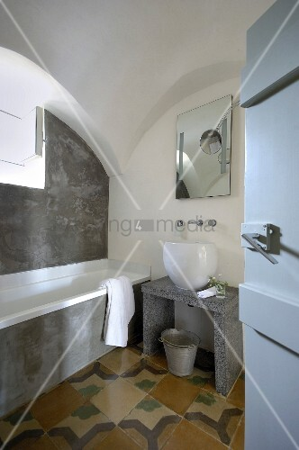 Bathroom with vaulted ceiling in restored period building