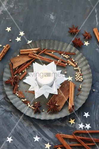 Folded white paper stars used as tealight holder