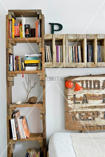 Bookcase made from reclaimed wood framing bed headboard