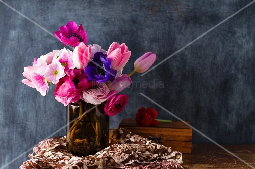 Bouquet of spring flowers against black wall