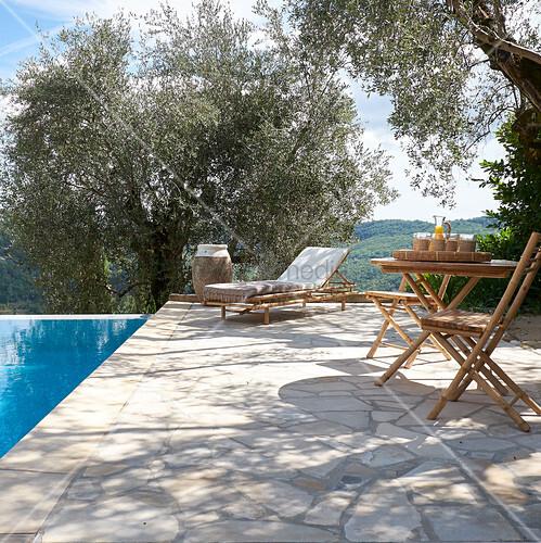 Stone terrace next to pool