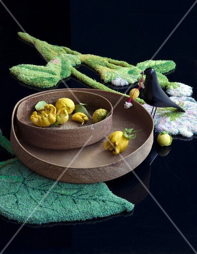Lemons on wooden trays on leaf-shaped rig