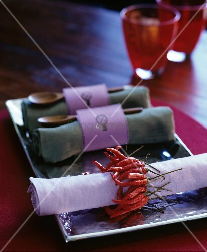 Rolled linen napkins with original napkin rings