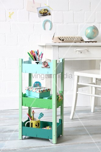 Serving trolley hand-made from fruit crates and painted in shades of green